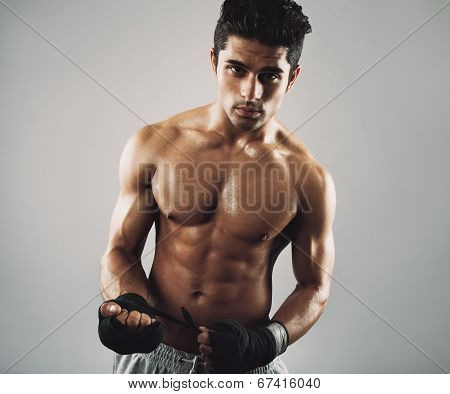 Tough Young Male Athlete On Grey Background
