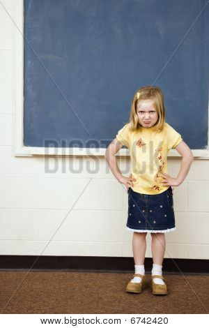 Girl With Sad Expression In Classroom
