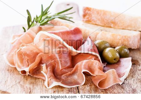 Ham With Olives On Wooden Background