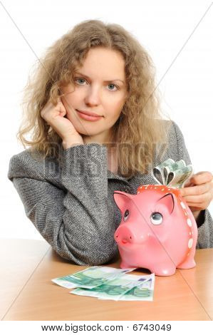 Business woman with a piggybank isolated on white