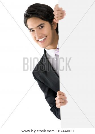 Business Man Comming Out From A Banner