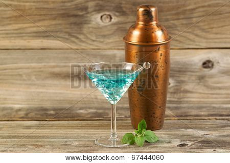 Freshly Made Mixed Drink With Mint On Weathered Wood
