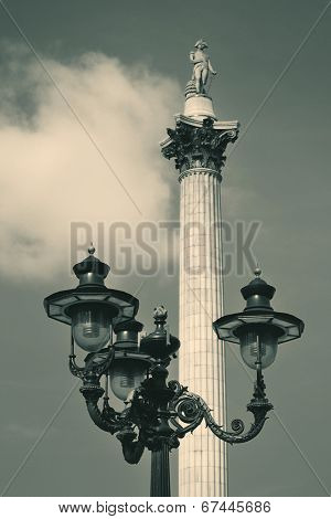 Nelson's Column and vintage lamp in London.