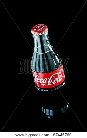 Thailand, Bangkok - June 29, 2014: Bottle Of Coca-cola On Black Background. Coca Cola Flavored Soft