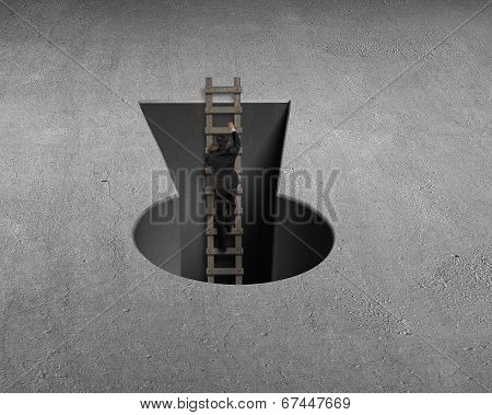 Businessman Climbing Out From Key Shape Hole