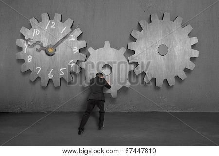 Pushing Concrete Gear For Other Two With Clock Face