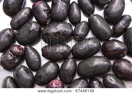 ripe Syzygium cumini fruits on an isolated background