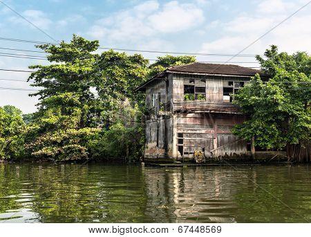 Slum on dirty canal in Thailand