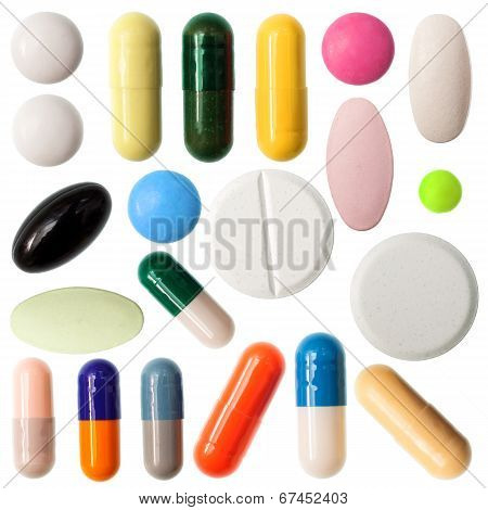 Pills And Capsules On White Background