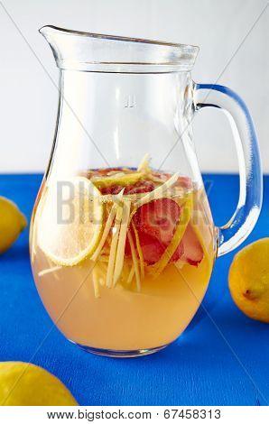Fresh ginger lemonade with strawberry in pithcer
