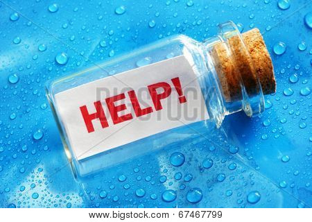 Help message in a bottle concept for sos, assistance, service and support