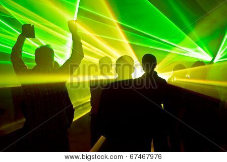 Lasers At A Nightclub And People Silhouettes