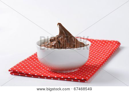 chocolate spread, served in the ceramic bowl on the dotted linen