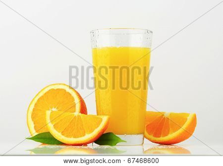 glass of fresh juice with pieces of oranges