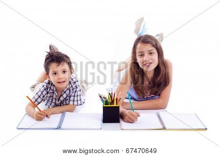Two kids drawing with colored pencils, isolated on white bakground