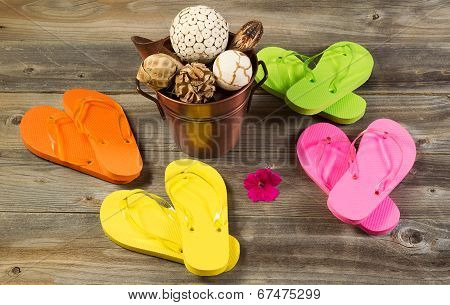 New Sandals With Other Spa Items On Rustic Wood