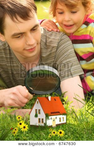 Father With Little Girl Looking On Small House Through Magnifier Collage