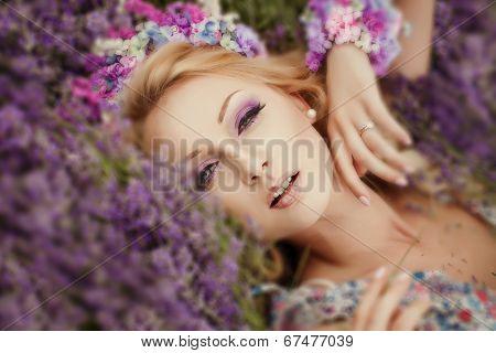 romantic portrait of beautiful woman on the lavender field