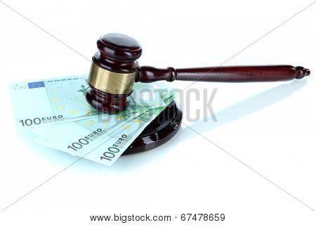Gavel and money isolated on white
