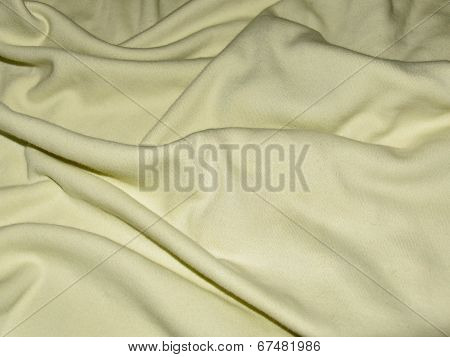Beige texture is dense fabric with pleats