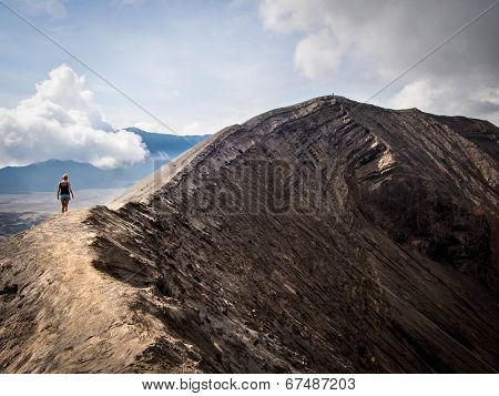 Hiker Walking Around Rim Of Gunung Bromo Volcano, Java, Indonesia
