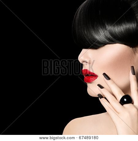 High Fashion Model Girl Portrait with Trendy Fringe Hair style, Make up and Manicure. Long Black Fringe Hairstyle, Black Matte Nail Polish and Red Matte Lipstick. Woman Makeup. Sexy Lips. Haircut