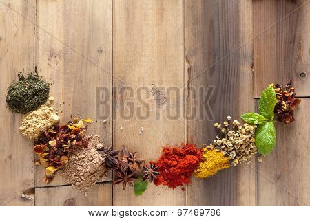 Herbs and spices forming a half circle border frame