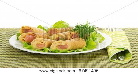 Flapjack with salmon and salad, cutlery