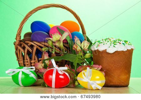 Basket, eggs with ribbons, an Easter cake