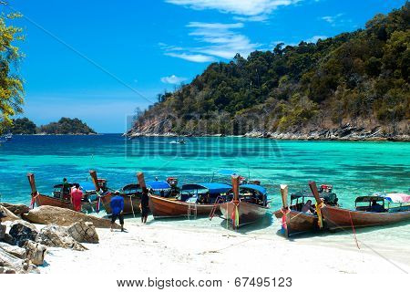 Lipe, Satun, Thailand - March 15, 2014: Fisherman Sailed Longtail Boat To Visit Beautiful Beach Of K