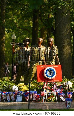 WASHINGTON, D.C. - MAY 26, 2014: People visit and lay flowers at the Vietnam Veterans Memorial during Memorial Day holiday on May 26, 2014, in Washington, D.C.