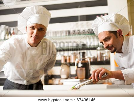 Chef Watching His Assistant Arranging Dish