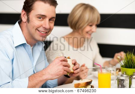 Couple Enjoying Delicious Breakfast