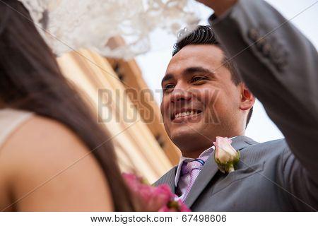 Happy Groom Looking At His Bride