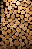 stock photo of firewood  - Closeup of chopped firewood logs stacked in a pile - JPG