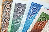 foto of zloty  - Polish colorful banknotes.  Polish Zloty -banknotes. Details.