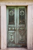 stock photo of burial-vault  - Front view of weathered and tarnished mausoleum door - JPG