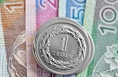 stock photo of zloty  - Polish coins stacked on a banknote. Polish Zloty .
