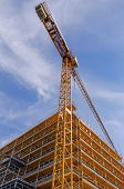 stock photo of scaffold  - Detail of a crane and scaffolds in an urban building - JPG