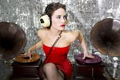 image of cabaret  - beautful sexy disco dj in red dress with gramophones - JPG
