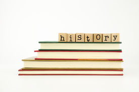 stock photo of annal  - history word on wood stamps stack on books knowledge and academic concept - JPG