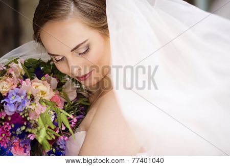 Close up of bride face with veil