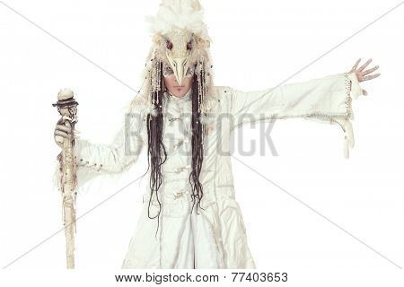 Artistic handsome man in a scenic suit of white raven. Ethnic costume. Isolated over white.