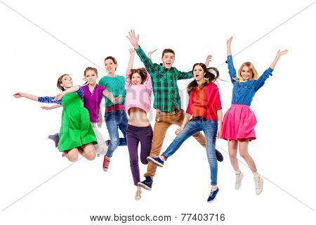 Large group of cheerful young people jumping for joy. Isolated over white.