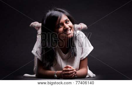 Prone Girl On The Floor Smiling