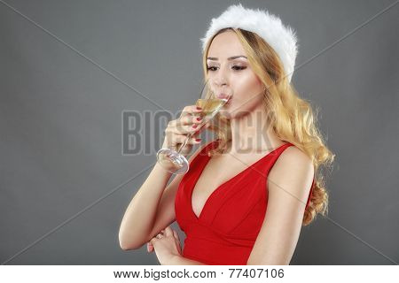 party, drinks, christmas, x-mas concept - smiling woman in red dress with a glass of champagne