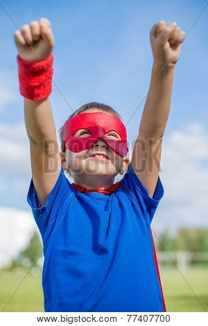 Superhero Holding Hands Up And Looking At The Sun