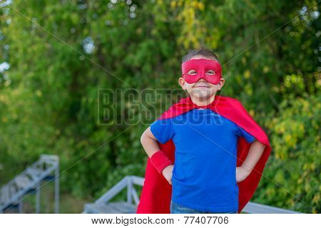 Superhero Standing With Hands On Hips And Smiling