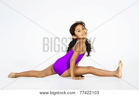 Young Cute Afro-american Girl Doing Gymnastics