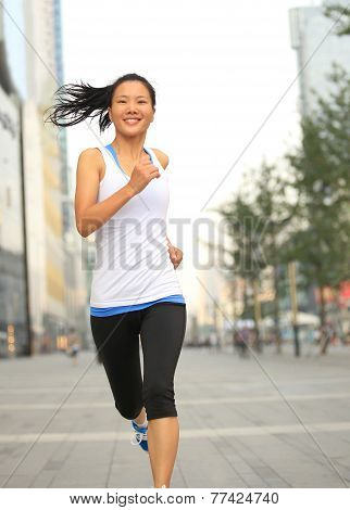 Runner athlete running on city road. woman fitness jogging workout wellness concept.